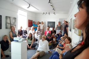Artist and audience at the opening in gallery 2.